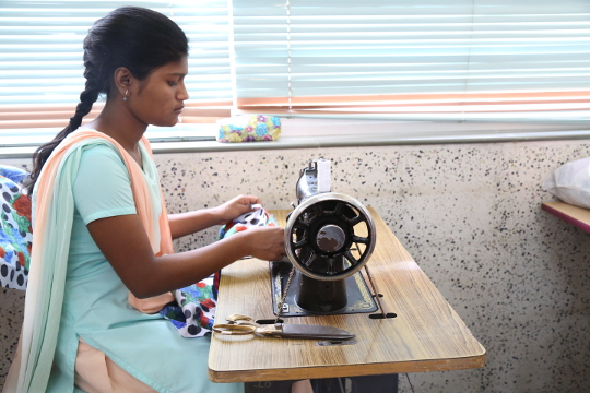 RGI Student sewing